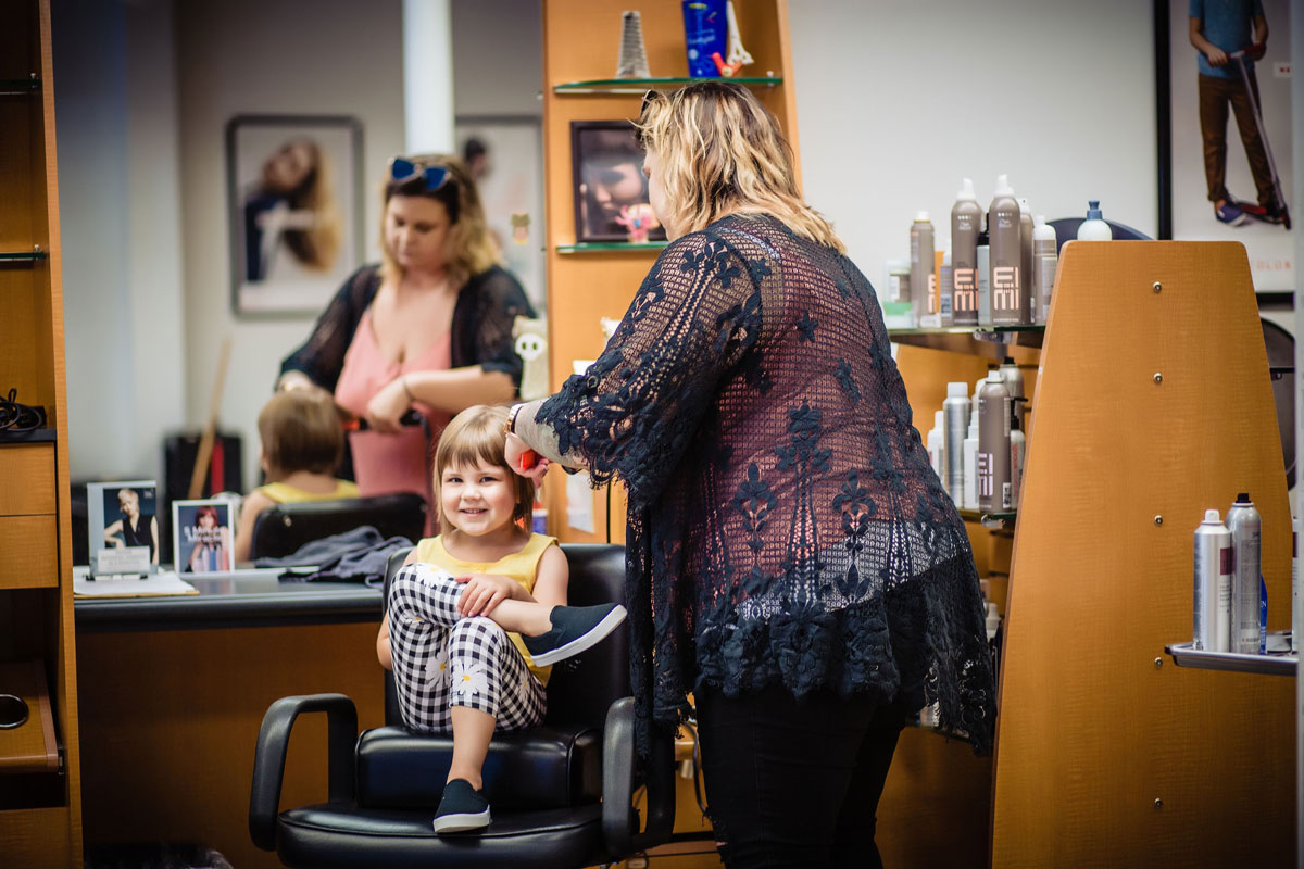 Fantastic Sam's Stylist styling young girl's hair