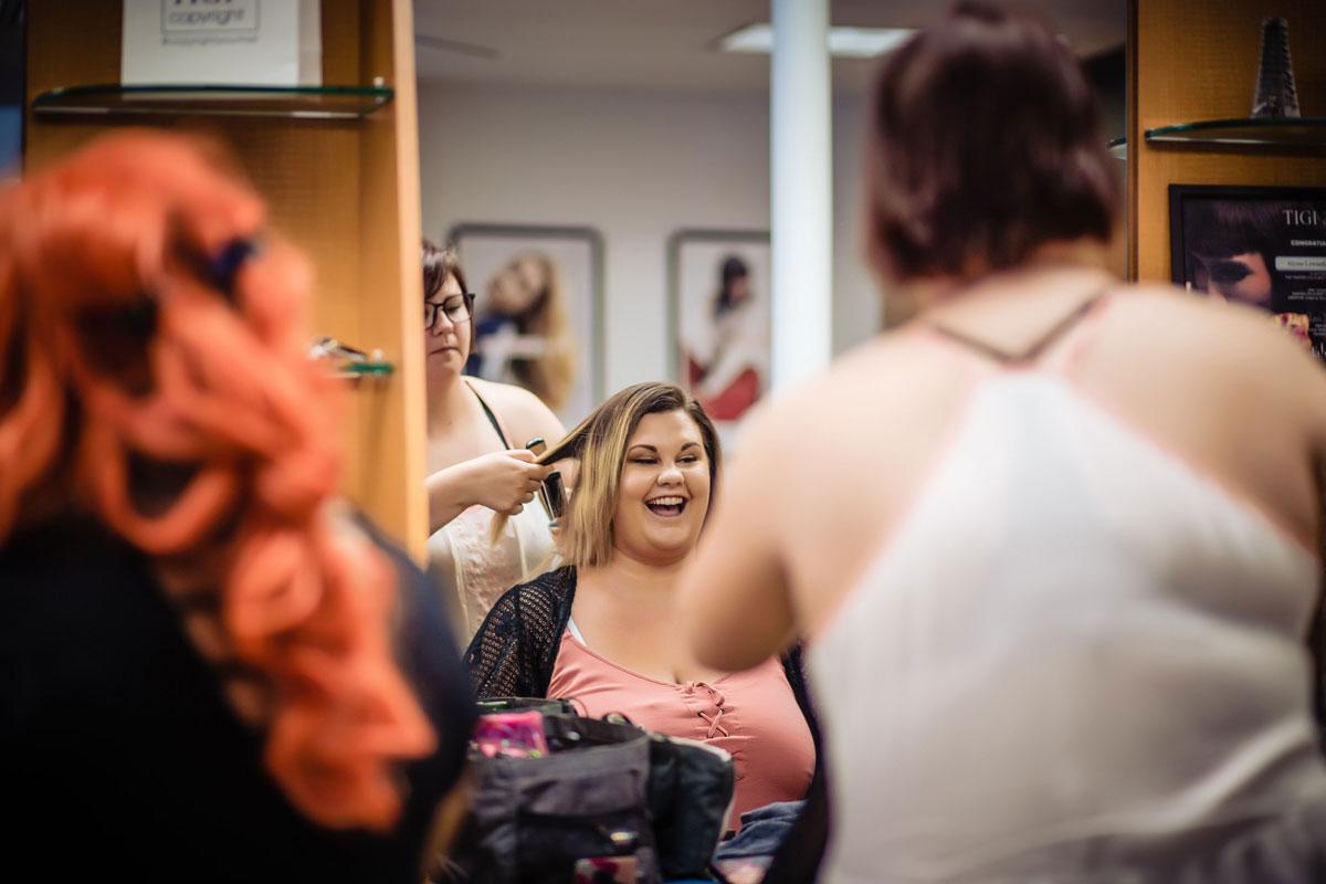 Fantastic Sam's Stylist cutting woman's hair