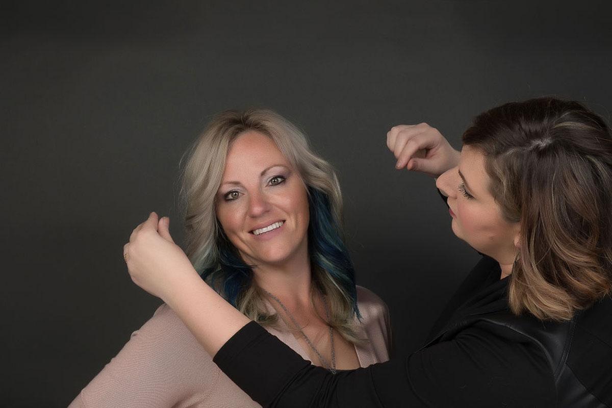 Fantastic Sam's Hairdresser styling Client's hair