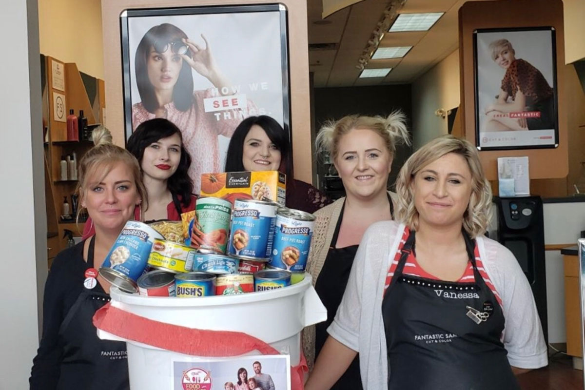 Stylists showing off food donations - group 3